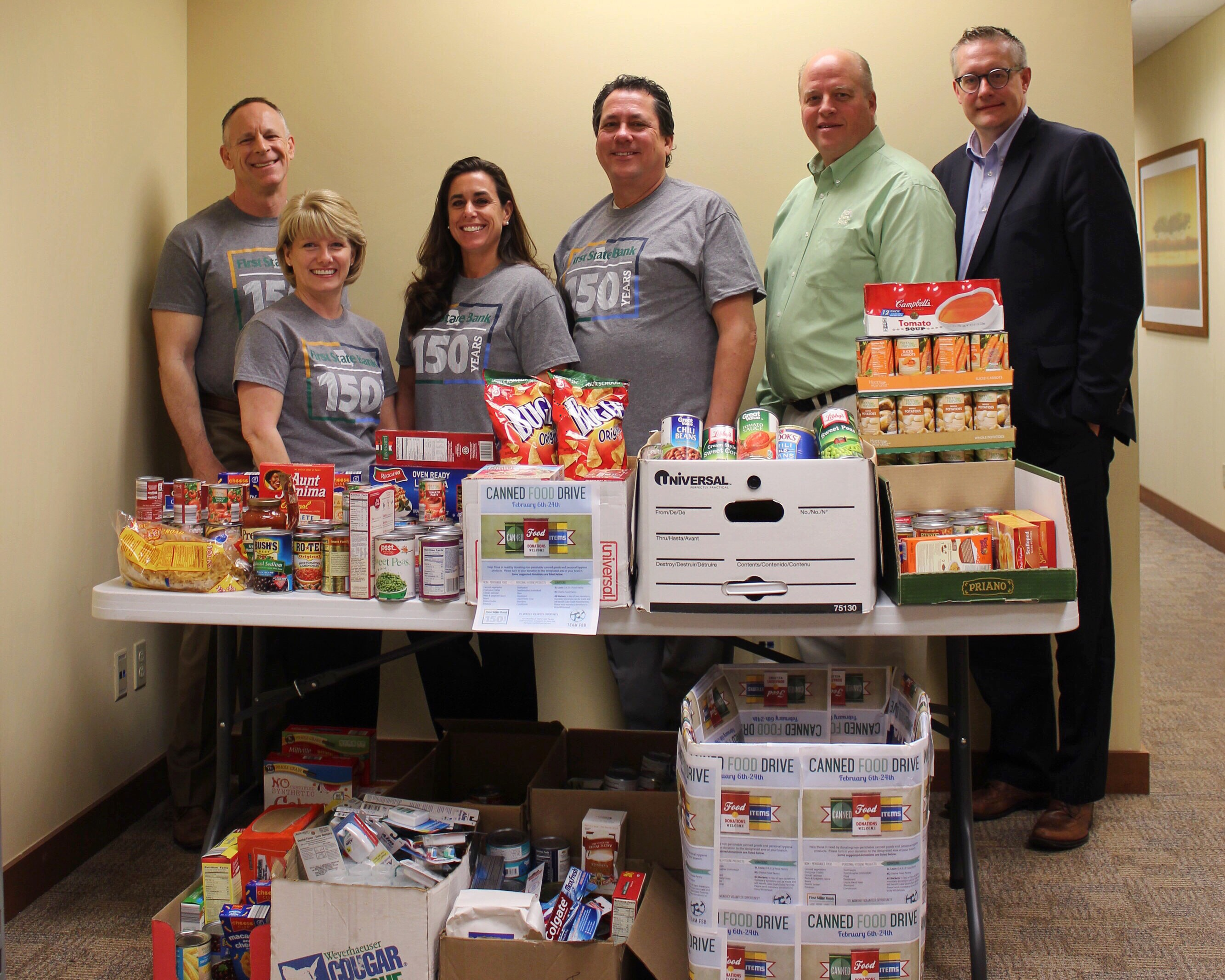 First State Bank- Baxter collects donations for local food drive.